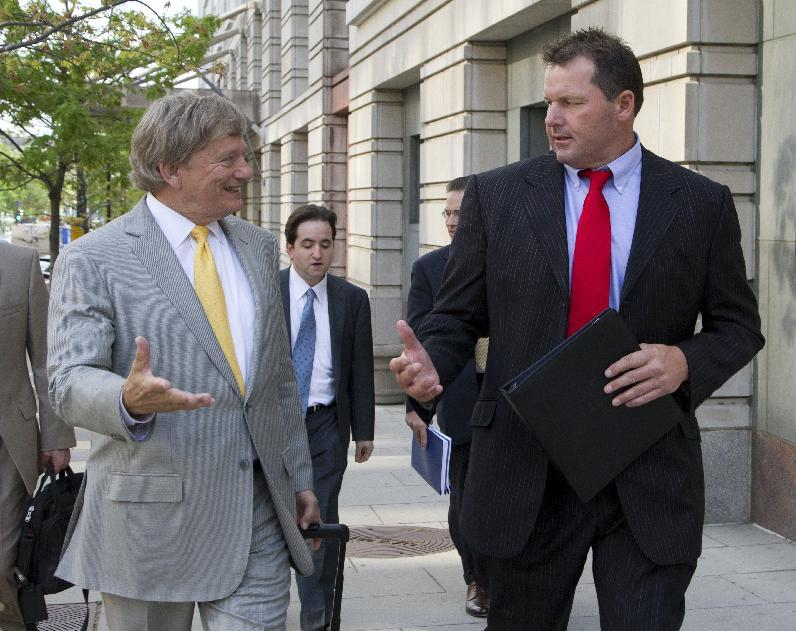 Former Major League Baseball pitcher Roger Clemens and his lawyer Rusty Hardin, left, leave Federal Court in Washington, as the second day of jury selection in his perjury trial wraps uo, Tuesday, April 17, 2012. (AP Photo/Manuel Balce Ceneta)