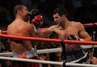 Britain's Carl Froch (right) fights Lucian Bute of Romania during their IBF super-middleweight title fight in Nottingham