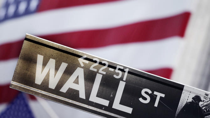 FILE - This Aug. 9, 2011 photo shows a Wall Street street sign near the New York Stock Exchange, in New York. U.S. stock futures are heading lower in early trading Tuesday, June 3, 2014, a day after major indexes reached new highs. (AP Photo/Mark Lennihan, File)