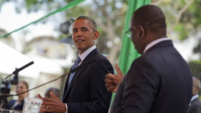 President Barack Obama listens as Senegalese President Macky Sall speaks during a news conference at the Presidential Palace, in Dakar, Senegal, Thursday, June 27, 2013. Obama is visiting Senegal, South Africa, and Tanzania on a week long trip. (AP Photo/Evan Vucci)