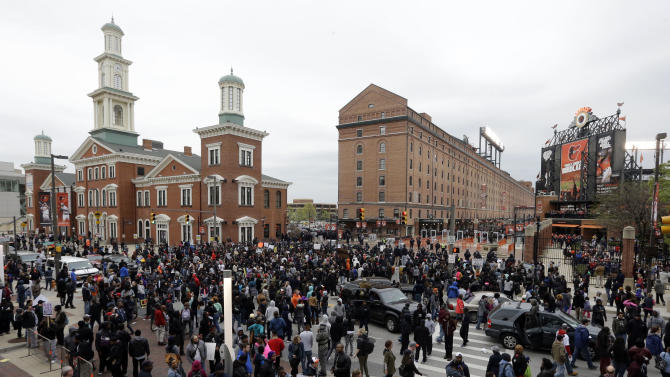 Protestors gather outside of Oriole Park at Camden Yards before a baseball game between the Boston Red Sox and the Baltimore Orioles after a rally for Freddie Gray, Saturday, April 25, 2015, in Baltimore. Gray died from spinal injuries about a week after he was arrested and transported in a police van. (AP Photo/Patrick Semansky)