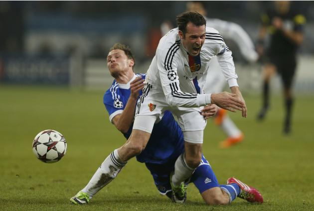 FC Basel's Streller fights for the ball with Hoewedes of Schalke 04 during their Champions League group E soccer match in Gelsenkirchen