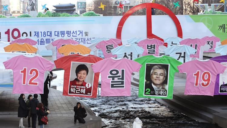 Election posters of presidential candidates Park Geun-hye, center left,  of the ruling Saenuri Party, and Moon Jae-in, center right,  of the main opposition Democratic United Party are   displayed over Seoul's Cheonggye Stream, South Korea, Tuesday, Dec. 18, 2012. The display made by the Seoul City's election management committee is aimed at encouraging people to vote in the Dec. 19 elections. (AP Photo/Ahn Young-joon)