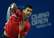 Novak Djokovic of Serbia serves before winning his quarter-final men's singles match against Jurgen Melzer of Austria at the China Open tennis tournament in the National Tennis Centre in Beijing on October 5, which Djokovic went on to win 6-1, 6-2