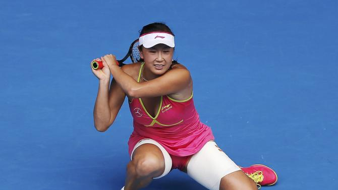 Peng of China crouches after a return to Sharapova of Russia during their women's singles match at the Australian Open 2015 tennis tournament in Melbourne