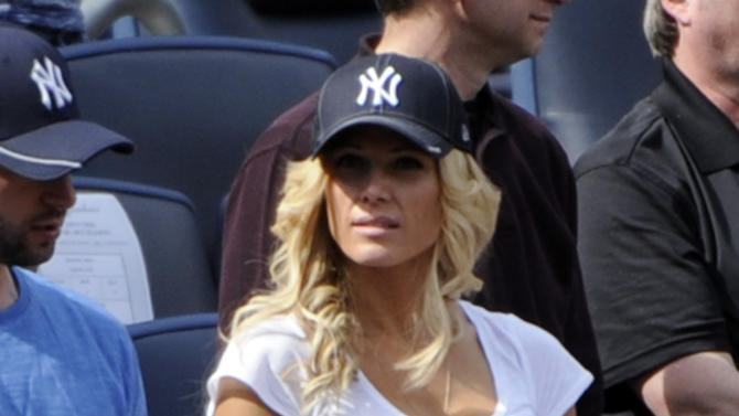 Retired wrestler Torrie Wilson watches the New York Yankees and Los Angeles Angels play a baseball game Saturday, April 14, 2012 at Yankee Stadium in New York. (AP Photo/Bill Kostroun)