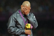 Dominican Republic's gold medalist Felix Sanchez cries on the podium of the men's 400m hurdles at the athletics event of the London 2012 Olympic Games on August 6, 2012 in London