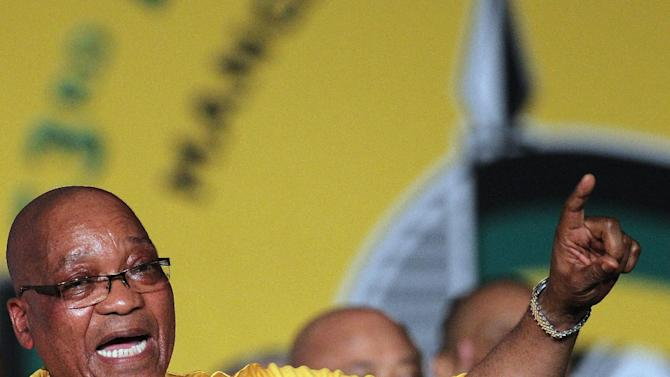 The ruling party African National Congress (ANC) president Jacob Zuma sings before  addressing delegates during the opening of their elective conference at the University of the Free State in Bloemfontein, South Africa, on Sunday, Dec. 16, 2012. Zuma acknowledged Sunday that corruption and violence have marred the image of his African National Congress as it changed from a liberation movement to governing party, but called on members to again support him to be its leader. (AP Photo/Themba Hadebe)