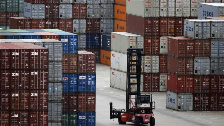 A container forklift drives past the container area at the Yangshan Deep Water Port, part of the newly announced Shanghai Free Trade Zone, south of Shanghai
