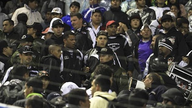 Members of Bolivia's police are seen amid Brazil's Corinthians fans after a flare killed San Jose supporter Kevin Beltran, 14, during a Copa Libertadores match in Oruro (Reuters)