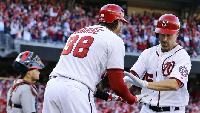Washington Nationals' Adam LaRoche, right, is greeted by teammate Michael Morse after hitting a solo home run in the second inning of Game 4 of the National League division baseball series against the St. Louis Cardinals on Thursday, Oct. 11, 2012, in Washington. (AP Photo/Alex Brandon)