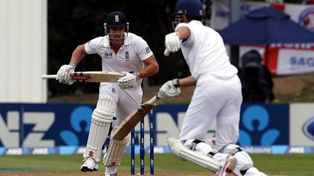 England's Nick Compton (L) takes a run with captain Alastair Cook during the fourth day of the first test against New Zealnd at the University Oval in Dunedin March 9, 2013 (Reuters)