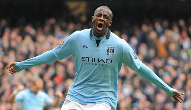 In a picture taken on February 24, 2013 Manchester City's Yaya Toure celebrates scoring against Chelsea at the Etihad Stadium in Manchester, northwest England