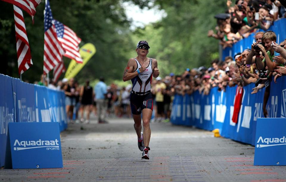 Mary Beth Ellis, of Colorado, nears the finish line just before winning the women's Ironman U.S. Championship triathlon in New York, Saturday, Aug. 11, 2012. (AP Photo/Craig Ruttle)