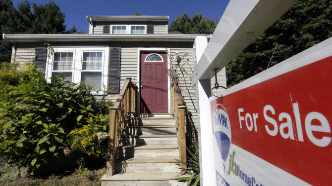 In this Wednesday, Sept. 18, 2013 photo a for sale sign hangs in front of a house in Walpole, Mass. Freddie Mac reports on mortgage rates for this week Thursday Oct. 24, 2013. (AP Photo/Steven Senne)