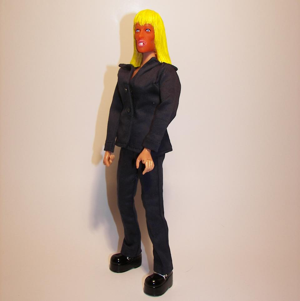 "This undated photo provided by HeroBuilders shows the novelty company's new ""tanorexic"" action figure based on Patricia Krentcil, the deeply tanned New Jersey mother accused of causing skin burns to her young daughter in a tanning booth. (AP Photo/HeroBuilders)"