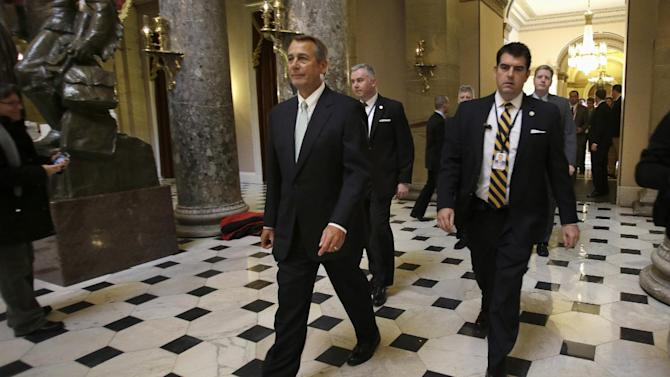 House Speaker John Boehner of Ohio leaves a news conference on Capitol Hill in Washington, Wednesday, Jan. 23, 2013 where he discussed the debt limit. The House overwhelmingly passed a bill Wednesday to permit the government to borrow enough money to avoid a first-time default for at least four months, defusing a looming crisis and setting the stage for a springtime debate over taxes, spending and the deficit. (AP Photo/Jacquelyn Martin)