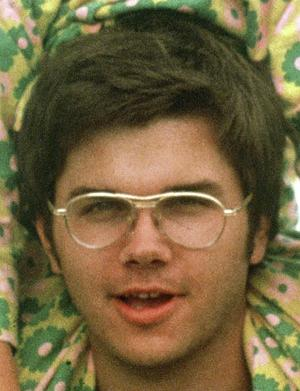 FILE - In this 1975 file photo, Mark David Chapman is seen at Fort Chaffee near Fort Smith, Ark. The Buffalo News reports that 57-year-old Mark David Chapman was transferred Tuesday, May 15, 2012 from Attica Correctional Facility to the nearby maximum security Wende Correctional Facility. A spokesman for the state prison system says the agency doesn't disclose why inmates are transferred. Chapman shot Lennon in December 1980 outside the Manhattan apartment building where the former Beatle lived. Chapman pleaded guilty to second-degree murder and was sentenced in 1981 to 20 years to life in prison.  (AP Photo/Greg Lyuan, File)