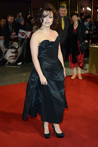 FILE - In this Wed., Dec. 5, 2012 file photo, Helena Bonham Carter poses for photographers as she arrives at the film premiere of &quot;Les Miserables&quot; at a cinema in central London. A report from Ancestry.com says Victor Hugo was a political colleague of a cousin of the 46-year-old actress. Carter stars as Madame Thenardier in the upcoming musical “Les Miserables.” (Photo by Jon Furniss/Invision/AP, File)