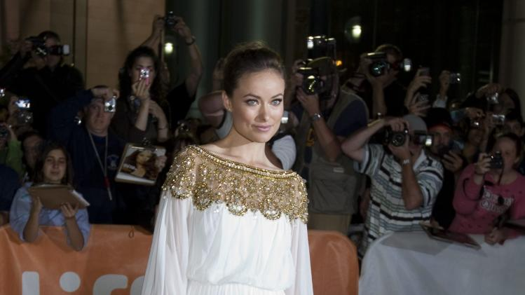 "Actress Olivia Wilde poses at the gala for the film ""Butter"" during the Toronto International Film Festival in Toronto Tuesday, Sept.  13, 2011.  (AP Photo/The Canadian Press, Darren Calabrese)"