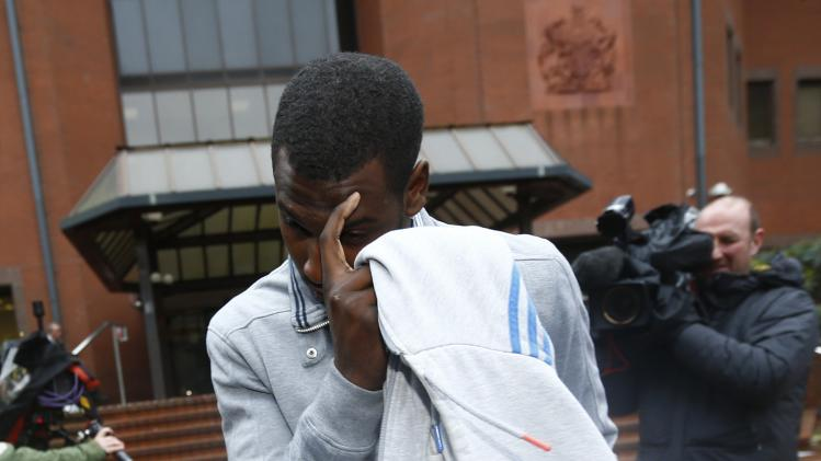Whitehawk FC soccer player Hakeem Adelakun leaves after appearing at Birmingham Crown Court accused of conspiring to defraud bookmakers by influencing the course of football matches and placing bets in Birmingham