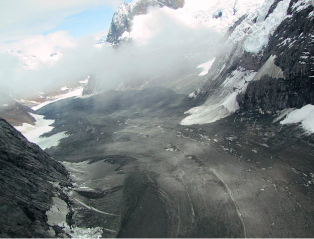 In this image provided by Drake Olson at flydrake.com, a landslide is seen at Glacier Bay National Park in Alaska on July 8, 2012.  When a cliff collapsed in Glacier Bay National Park, it sent rock an