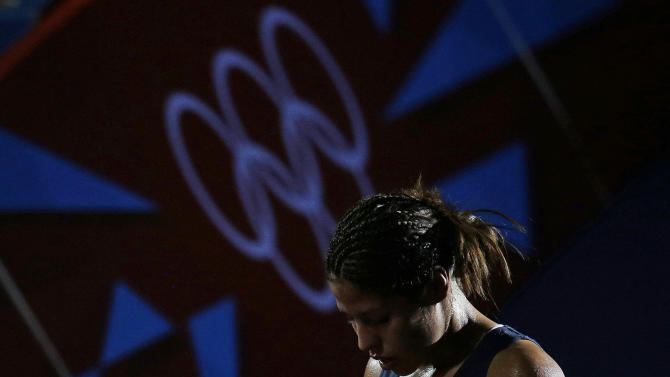 Marlen Esparza, of the United States  leaves following a fight against China's Ren Cancan, in the women's semifinal flyweight 51-kg boxing match at the 2012 Summer Olympics, Wednesday, Aug. 8, 2012, in London. (AP Photo/Patrick Semansky)