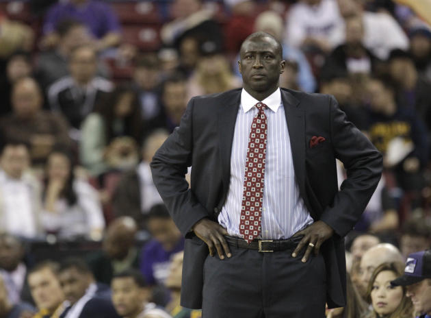 Utah Jazz head coach Ty Corbin watches the action during the first quarter of an NBA basketball game against Sacramento Kings  in Sacramento, Calif., Wednesday, Dec. 11, 2013