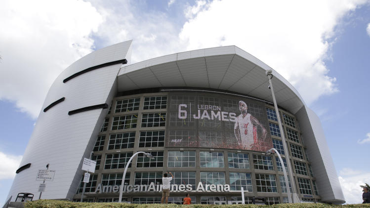 An image of LeBron James is flashed on the side of the American Airlines Arena, Friday, July 11, 2014 in downtown Miami, where the Miami Heat NBA basketball team play. James is returning home to Ohio, reversing the decision he made four years ago that led to two NBA titles in Miami and crushed Cleveland Cavalier fans. (AP Photo/Wilfredo Lee)