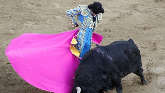 French bullfighter Sebastian Castella performs a pass to a bull during a bullfighting festival at Canaveralejo bullring in Cali