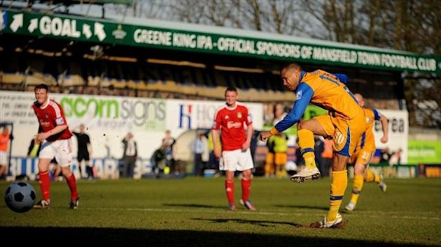 Matt Green slots home the penalty which sends Mansfield into the Football League