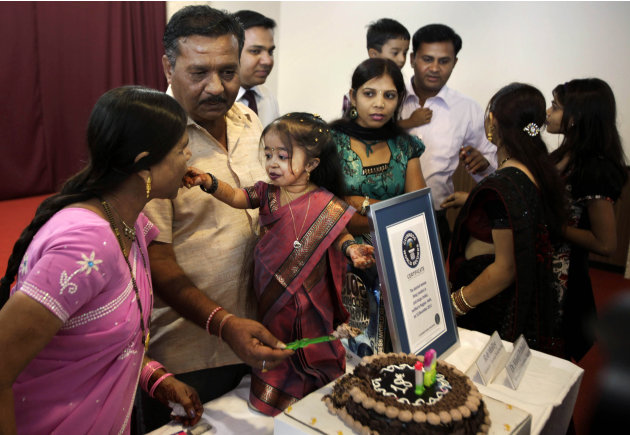 Jyoti Amge celebrates after getting the title of the Shortest Woman of the World, in Nagpur, India, Friday, Dec. 16, 2011. Amgem was named the world's shortest measuring 62.8 centimeters (24.7 inches)