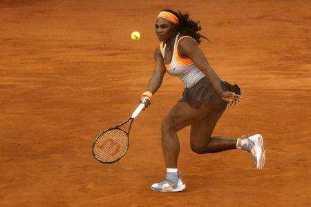 Serena Williams of the U.S. returns the ball to Sloane Stephens of the U.S. at the Madrid Open tennis tournament in Madrid
