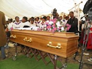 &lt;p&gt;People gather around the coffin of the woman who collapsed and died on hearing her mine worker had been killed in violence at the Lonmin platinum mine in Marikana. A South African court Monday was due to start releasing 270 miners Monday arrested over the deaths of 34 of their colleagues killed by police, after prosecutors withdrew murder charges against them.&lt;/p&gt;