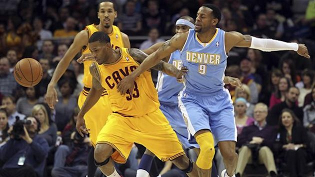 Cleveland Cavaliers Alonzo Gee (33) gets the ball knocked away by Denver Nuggets Andre Iguodala (9) during the first quarter of their NBA basketball game in Cleveland,