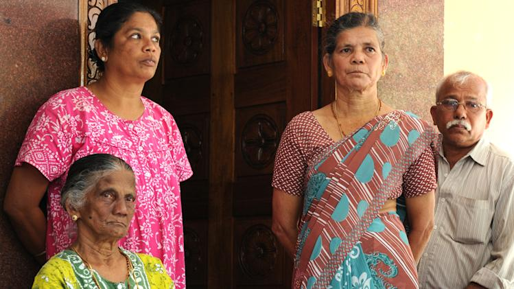 In this Saturday, Dec. 8, 2012 photo, Carmine Barboza, seated left, Mother-in-law of nurse at King Edward VII hospital, in London, Jacintha Saldanha, is seen with her unidentified relatives as she speaks to the media after knowing about Saldanha's death in central London, at their village house in Shirva north of Mangalore, India. Australian radio hosts managed to impersonate Queen Elizabeth II and Prince Charles and received confidential information about the Duchess of Cambridge's medical condition, in a hoax phone call to the King Edward VII hospital where the pregnant Duchess was staying and which was broadcast on-air. The controversial prank took a dark twist three days later with the death of nurse Saldanha, a 46-year-old mother of two, who was duped by the DJs despite their Australian accents. (AP Photo)