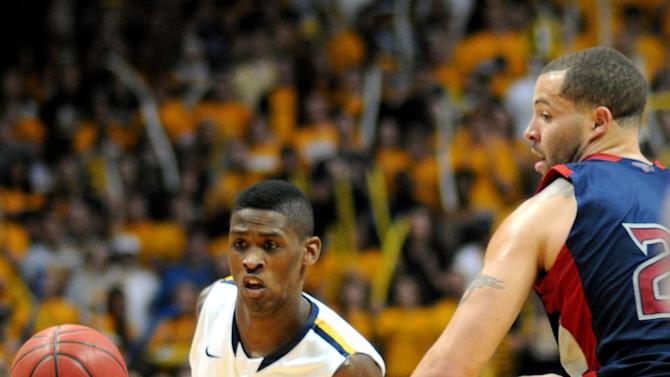Murray State's Zay Jackson (10) drives around St. Mary's Rob Jones during the second half of an NCAA college basketball game on Saturday, Feb. 18, 2012, in Murray, Ky. Murray State won 65-51. (AP Photo/Stephen Lance Dennee)