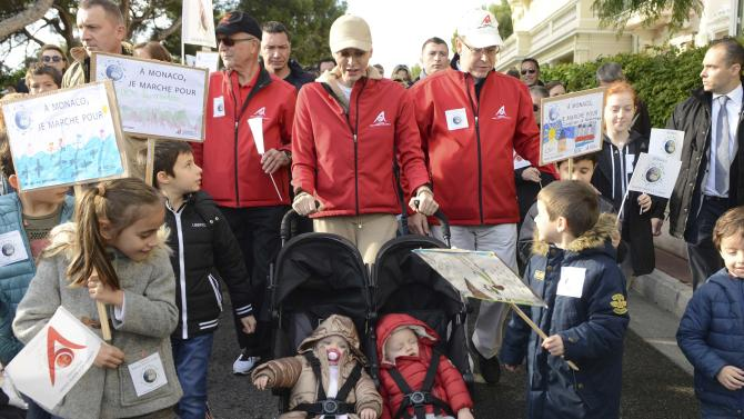 Prince Albert II of Monaco and his wife Princess Charlene of Monaco with their twins Prince Jacques and Princess Gabriella participate in a climate march in Monaco