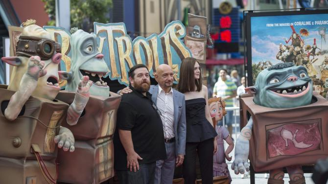 "Cast members Kingsley, Fanning and Frost pose with Boxtroll characters at the premiere of ""The Boxtrolls"" at Universal Studios City Walk in Universal City"