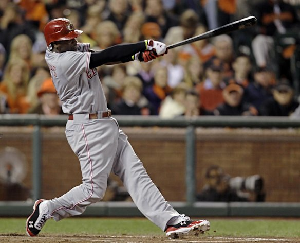 Cincinnati Reds&#39; Brandon Phillips swings on a two-run home run in the third inning of Game 1 of the National League division baseball series against the San Francisco Giants in San Francisco, Saturday, Oct. 6, 2012. (AP Photo/Eric Risberg)