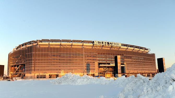 In this photo taken Feb. 9, 2013, snow is piled high in a parking lot outside of MetLife Stadium in East Rutherford, N.J. The NFL says it's ready to get the 2014 Super Bowl played at the stadium no matter what the weather conditions are early next February.  (AP Photo/Bill Kostroun)