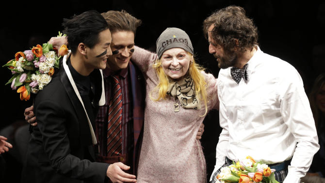 British fashion designer Vivienne Westwood, second from right, is flanked by husband Andreas Kronthaler, right and models on the catwalk after the presention of the Vivienne Westwood men's Fall-Winter 2013-14 collection, part of the Milan Fashion Week, unveiled in Milan, Italy, Sunday, Jan. 13, 2013. (AP Photo/Luca Bruno)
