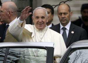 Pope Francis waves to journalists as he leaves the …