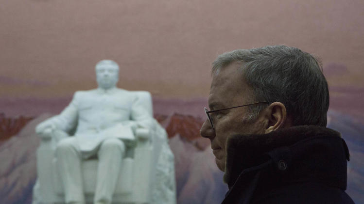 Executive Chairman of Google, Eric Schmidt stands near a statue of the late North Korean leader Kim Il Sung during a tour of the Grand Peoples Study House in Pyongyang, North Korea on Wednesday, Jan. 9, 2013. (AP Photo/David Guttenfelder)
