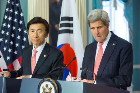 U.S. Secretary of State Kerry listens to a question as he and South Korea's Foreign Minister Yun talk to reporters about the 2+2 Ministerial meetings, at the State Department in Washington