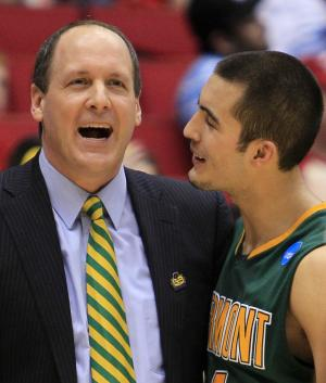 Vermont head coach John Becker, left, hugs guard Four McGlynn after they defeated Lamar 71-59 in an NCAA first-round college basketball tournament game, Wednesday, March 14, 2012, in Dayton, Ohio. McGlynn led Vermont  with 18 points. (AP Photo/Al Behrman)