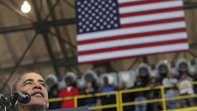 President Barack Obama speaks Tuesday, February 26, 2013 at Newport News Shipbuilding as part of his public campaign to sway Congress to block automatic spending cuts in defense and domestic programs that are scheduled to begin on March 1. (AP Photo/The Virginian-Pilot, Steve Earley)  MAGS OUT