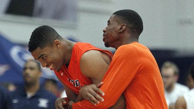 UTEP guard Lew Stallworth, left, gets a hug from an unknown teammate after defeating Xavier in an NCAA college basketball semifinal game at the Wooden Legacy tournament in Fullerton, Calif., Friday, Nov. 28, 2014. UTEP won the game 77-73. (AP Photo/Alex Gallardo)