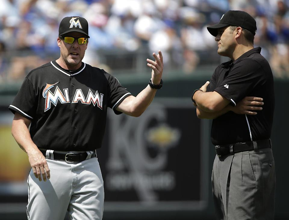 Marlins slip by sloppy Royals for 5-2 win