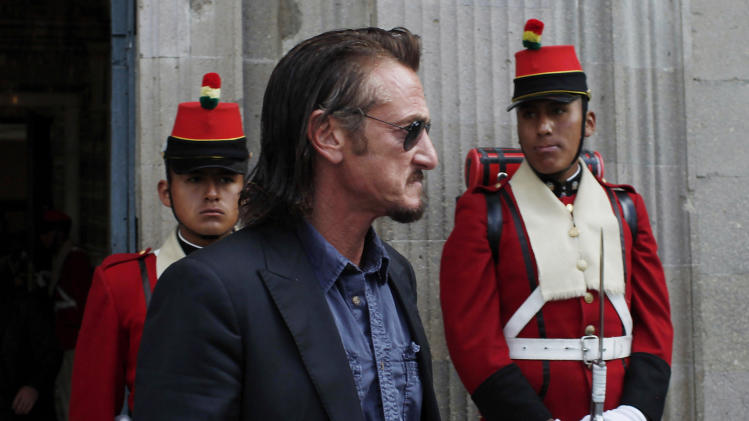FILE - In this Oct. 30, 2012 file photo, U.S. actor Sean Penn leaves the presidential palace after meeting with Bolivia's President Evo Morales in La Paz, Bolivia. In an unlikely tale: Jacob Ostreicher, an Orthodox Jew from New York City comes to Bolivia to rescue a rice-growing venture, gets thrown in jail on suspicion of money laundering and, aided by Penn, winds up triggering one of the biggest scandals of Evo Morales' presidency.  The saga came to light 18 months ago when Ostreicher was arrested while trying to salvage a multimillion-dollar investment he was managing for Swiss partners. After Penn directly interceded on Ostreicher's behalf, it could now be reaching its end game. (AP Photo/Juan Karita, File)